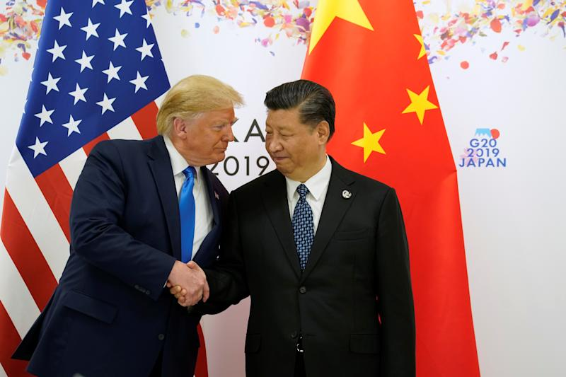 U.S. President Donald Trump shakes hands with China's President Xi Jinping before starting their bilateral meeting during the G20 leaders summit in Osaka, Japan, June 29, 2019. REUTERS/Kevin Lamarque