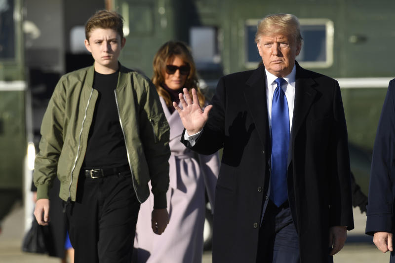 President Donald Trump, first lady Melania Trump and their son Barron Trump walk toward Air Force One at Andrews Air Force Base in Md., Friday, Jan. 17, 2020. The Trumps are heading to Florida to spend the weekend at their Mar-a-Lago estate. (AP Photo/Susan Walsh)
