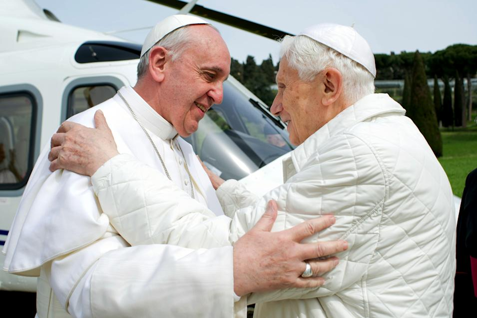 """In this photo provided by the Vatican paper L'Osservatore Romano, Pope Francis meets Pope emeritus Benedict XVI in Castel Gandolfo Saturday, March 23, 2013. Pope Francis has traveled to Castel Gandolfo to have lunch with his predecessor Benedict XVI in a historic and potentially problematic melding of the papacies that has never before confronted the Catholic Church. The Vatican said the two popes embraced on the helipad. In the chapel where they prayed together, Benedict offered Francis the traditional kneeler used by the pope. Francis refused to take it alone, saying """"We're brothers,"""" and the two prayed together on the same one. (AP Photo/Osservatore Romano, HO)"""