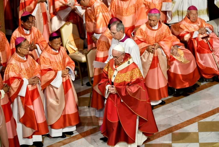 Pope Francis's second mass in Thailand was packed with bishops wearing brilliant red and gold robes custom-made for the occasion