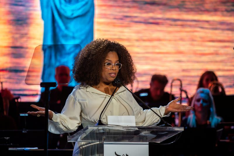 FILE PHOTO: Oprah Winfrey speaks at the opening celebration of the Statue of Liberty Museum on Liberty Island in New York