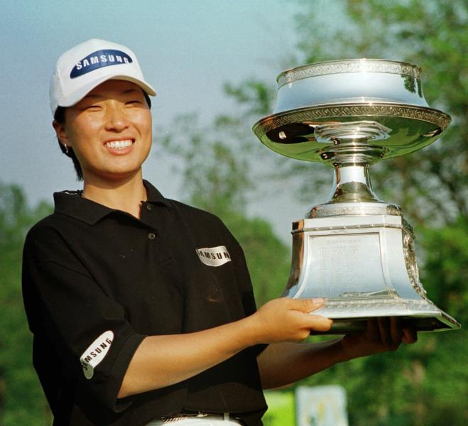FILE - In this May 17, 1998, file photo, Se Ri Pak of South Korea poses with her trophy after winning the LPGA McDonald's Championship at the DuPont Country Club in Rockland, Del. It was 22 years ago this week that Pak burst onto the LPGA scene with her first major. (AP Photo/George Widman, File)