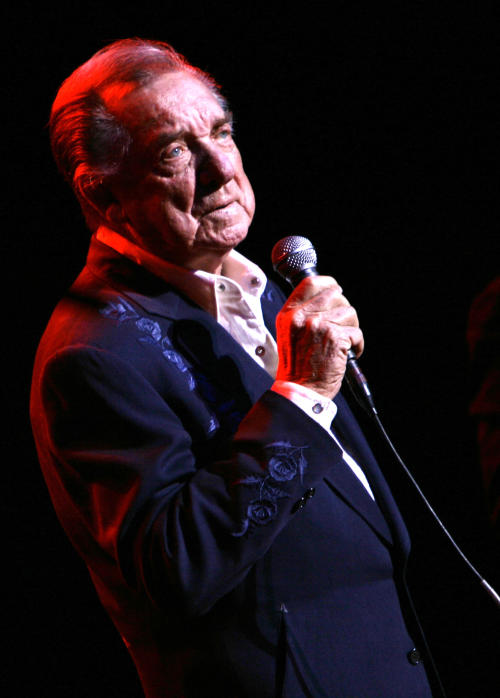 FILE - In this March 10, 2007 file photo, Ray Price performs at the Aladdin Theater for the Performing Arts in Las Vegas. A statement issued by East Texas Medical Center in Tyler says that country music star Price was discharged Thursday, Dec. 12, 2013, and will receive hospice care at his home in Mount Pleasant, Texas. (AP Photo/Laura Rauch, File)