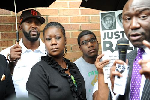 The family of Trayvon Martin, from left, father Tracy Martin, mother Sybrina Fulton, and brother Jahvaris Fulton visit Birmingham, Ala. Thursday, May 3, 2012 for a rally at Kelly Ingram Park. (AP Photo/The News, Linda Stelter) MAGS OUT