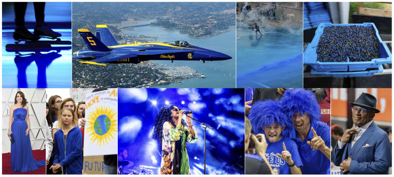 "This combination of photos shows, top row from left, Blue light projected during the opening ceremony of the ISU World Championships Speed Skating Sprint in the Netherlands, on Feb. 23, 2019, U.S. Navy Blue Angel flying over Sausalito, Calif., on  Oct. 10, 2019, Police firing blue-colored water at protestors in Hong Kong on Aug. 31, 2019, a tray of wild blueberries at the Coastal Blueberry Service in Union, Maine on Aug. 24, 2018, bottom row from left, actress-writer Tina Fey wearing a blue gown at the Oscars on Feb. 24, 2019, Swedish youth climate activist Greta Thunberg, wearing a blue sweatshirt, during a protest outside the White House in Washington on Sept. 13, 2019, H.E.R. performing under blue lights at the Coachella Music & Arts Festival in Indio, Calif. on April 14, 2019, Duke fans wearing blue wigs before an NCAA college basketball game against Florida State in Tallahassee, Fla., on Jan. 12, 2019 and ""Today"" show co-host Al Roker wearing blue eye glasses on the set in New York on April 5, 2019. The Pantone Color Institute has named Classic Blue as its color of the year for 2020.  (AP Photo)"