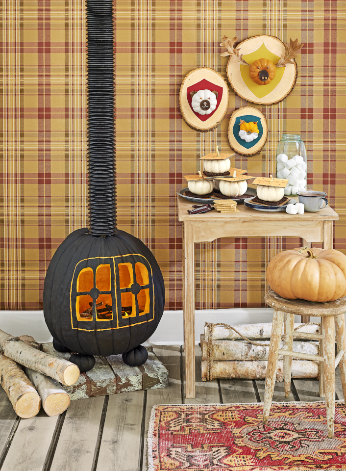 """<p>Warm up your front porch with this adorable wood-burning stove idea. It's pretty easy to create, and <em>Country Living</em> even has a stencil for you to use!</p><p><a href=""""https://www.countryliving.com/diy-crafts/g279/pumpkin-carving-ideas/?slide=5"""" target=""""_blank""""><em>Get the tutorial at Country Living »</em> </a></p>"""