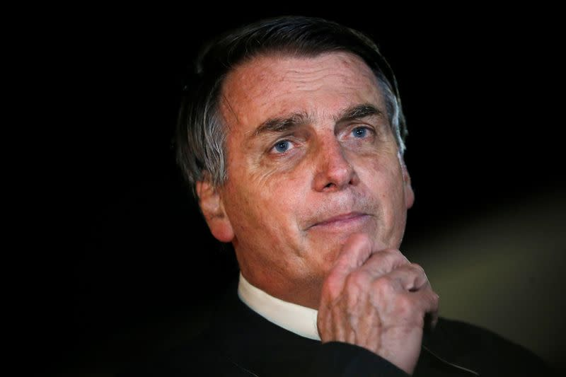 In video, Bolsonaro says wanted cops replaced to stop family being 'screwed'