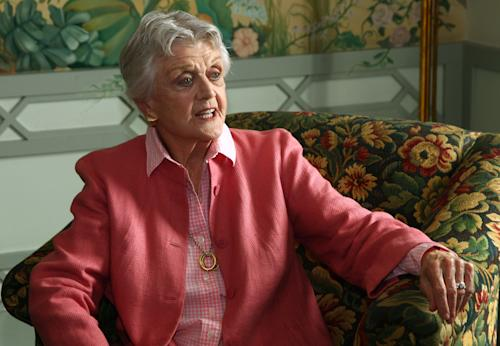 FILE - In this Jan. 7, 2013 file photo, actress Angela Lansbury poses for photos in Sydney, Australia. Lansbury the 88-year-old actress was one of more than 1,000 people who were recognized by Britain's Queen Elizabeth II in the New Year's Honors List. For the first time since the Order of the British Empire was founded in 1917, most of them were women. (AP Photo/Rick Rycroft, File)