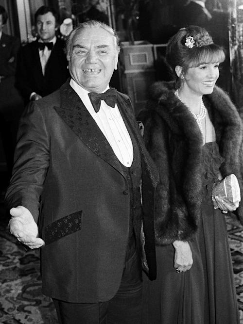 FILE - In this Feb. 29, 1980, file photo, actor Ernest Borgnine arrives with his wife, Tova, at the American Film Institute's salute to actor Jimmy Stewart in Beverly Hills, Calif. A spokesman said Sunday, July 8, 2012, that Borgnine has died at the age of 95. (AP Photo/ Lennox McLendon, File)
