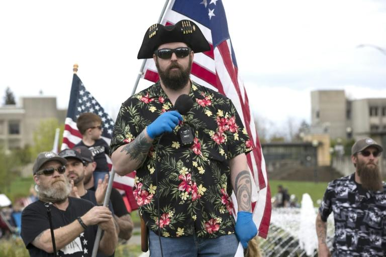 """The """"Boogaloo"""" movement (supporters pictured April 2020 in Olympia, Washington), which has adopted Hawaiian shirts as a uniform, promotes """"a coming civil war and/or collapse of society"""""""