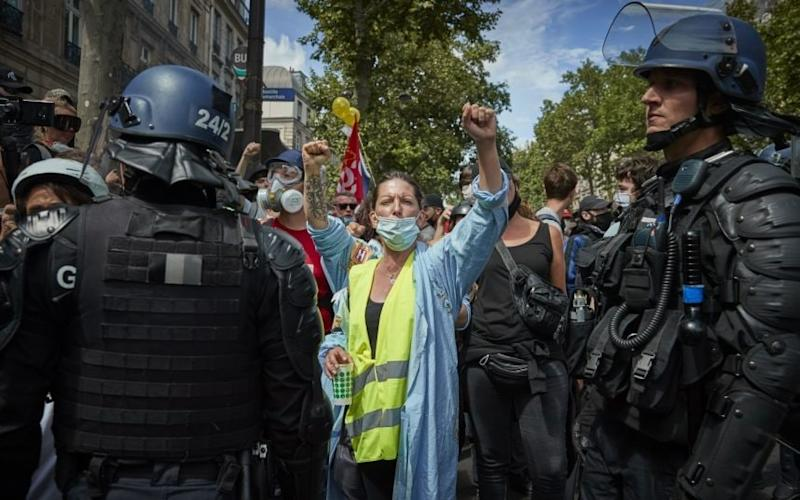 Gilets Jaunes protesters chant at a rally near Place de la Bastille in Paris.CREDIT: GETTY - Kiran Ridley/Getty