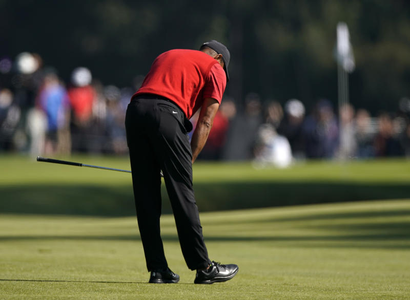 Tiger Woods reacts after hitting his third shot on the 11th hole during the final round of the Genesis Invitational golf tournament at Riviera Country Club, Sunday, Feb. 16, 2020, in the Pacific Palisades area of Los Angeles. (AP Photo/Ryan Kang)