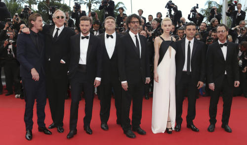Cast members, from left, Garrett Hedlund, T-Bone Burnett, Justin Timberlake, John Goodman, Joel Coen, Carey Mulligan, Oscar Isaac, and Ethan Coen pose for photographers as they arrive for the screening of Inside Llewyn Davis at the 66th international film festival, in Cannes, southern France, Sunday, May 19, 2013. (Photo by Joel Ryan/Invision/AP)