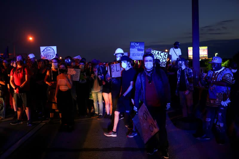 FILE PHOTO: Protesters block a freeway during a rally against racial inequality and the police shooting death of Rayshard Brooks, in Atlanta