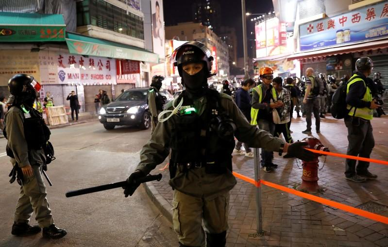 Hong Kong holds its breath ahead of polls amid lull in violence