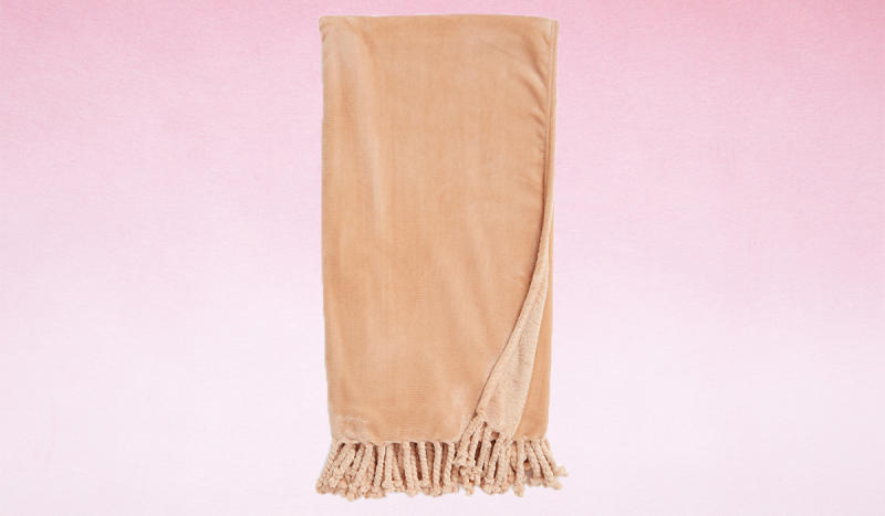 Curl up with this apricot-hued blanket. (Photo: Nordstrom)