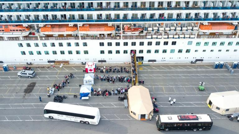 On the West Coast the Grand Princess cruise ship docked at California's port of Oakland, for more than 2,400 passengers to be taken into treatment, or placed in quarantine