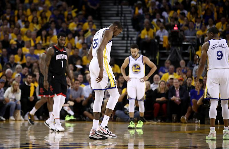 Kevin Durant of the Golden State Warriors walks off the court after injuring himself against the Houston Rockets during Game Five of the Western Conference Semifinals of the 2019 NBA Playoffs at ORACLE Arena on May 08, 2019 in Oakland, California.