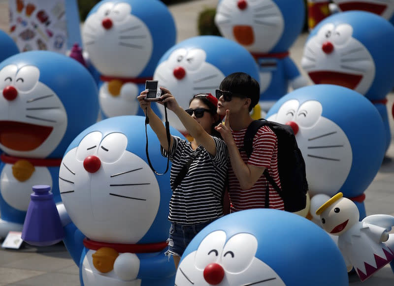 File picture of a couple snapping a selfie among Doraemon figures during an exhibition in Seoul August 31, 2015. — Reuters pic