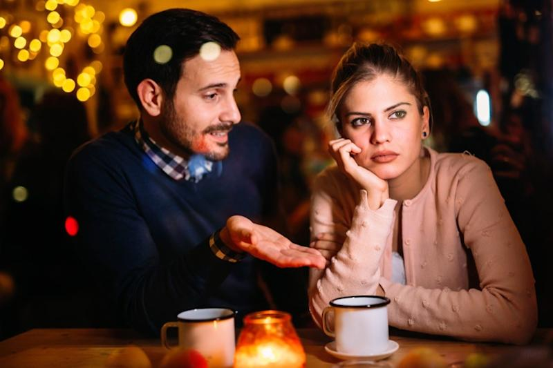 Couple is having relationship problems at dinner
