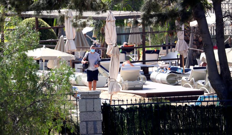 FILE PHOTO: A guest wears a protective face mask as he walks around inside H10 Costa Adeje Palace hotel, which is on lockdown after the novel coronavirus has been confirmed in Adeje