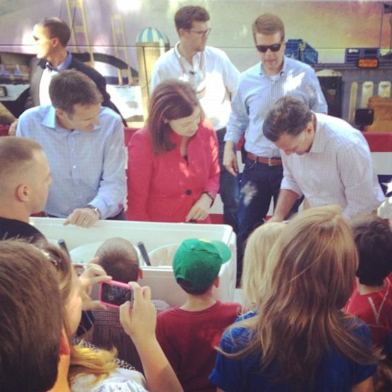 Former Minnesota Gov. Tim Pawlenty and New Hampshire Sen. Kelly Ayotte, both frequently discussed as possible running mates for Mitt Romney, scoop ice cream in Milford, NH. (Michael P. Falcone/ABC News)