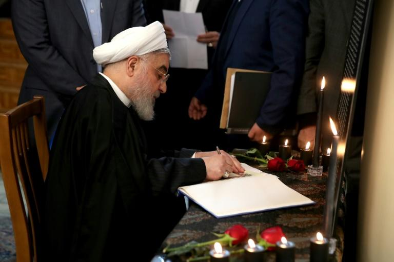 Iranian President Hassan Rouhani signs a book of condolences for passengers on a Ukrainian airliner shot down in a catastrophic error