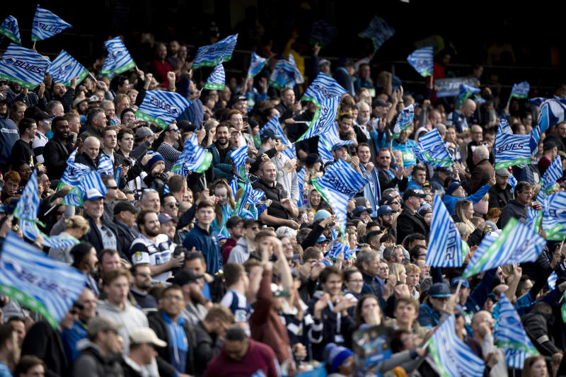 Auckland Blues supporters cheer their team during the Super Rugby Aotearoa rugby match between the Blues and the Hurricanes at Eden Park, in Auckland, New Zealand, Sunday, June 14, 2020. The Blues defeated the hurricanes 30-20. (Dean Purcell/New Zealand Herald via AP)