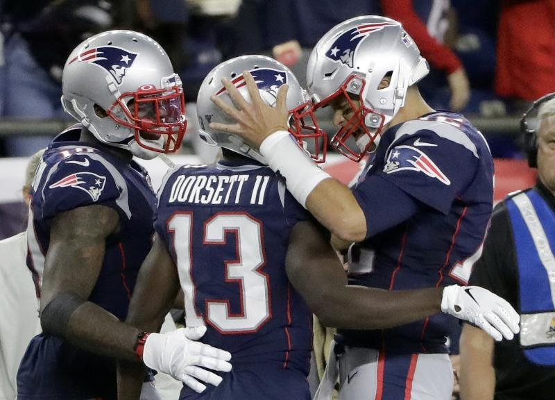 New England Patriots quarterback Tom Brady, right, celebrates his touchdown pass to Phillip Dorsett, center, in the second half of an NFL football game against the Pittsburgh Steelers, Sunday, Sept. 8, 2019, in Foxborough, Mass. (AP Photo/Steven Senne)