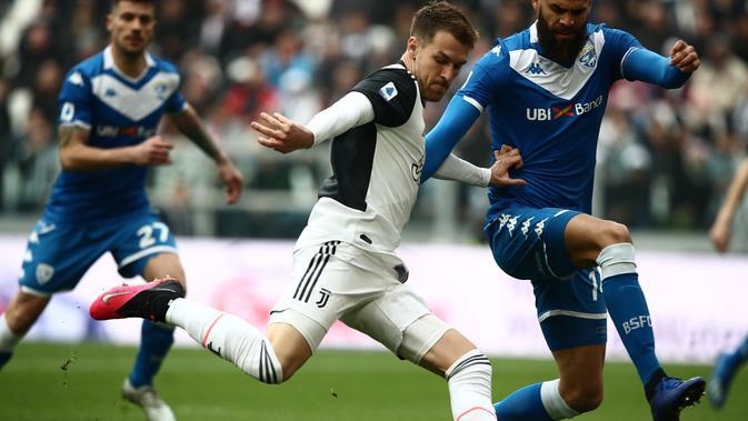 Gelandang Juventus, Aaron Ramsey saat pertandingan melawan Brescia Minggu, (16/2/2020) (Isabella BONOTTO / AFP)