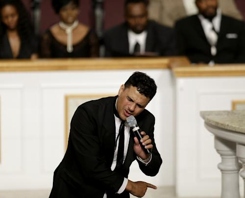 Chico DeBarge performs at the funeral service of Chris Kelly of the rap duo Kris Kross, Thursday, May 9, 2013, in Atlanta. The 34-year-old Kelly was found dead May 1 of a suspected drug overdose. Kriss Kross, the rap duo of Kelly and Chris Smith, was introduced to the music world in 1992 by music producer and rapper Jermaine Dupri after he discovered the pair at a mall in southwest Atlanta. (AP Photo/David Goldman)