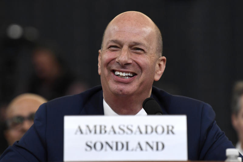 "FILE -In this Nov. 20, 2019, file photo, U.S. Ambassador to the European Union Gordon Sondland testifies before the House Intelligence Committee on Capitol Hill in Washington. The ""three amigos"" used to mean just one thing in Washington -- the trio of globe-trotting senators led by John McCain who brought American idealism to the trouble spots of the world. Now, it refers to another trio, the Trump envoys pushing Ukraine to pursue investigations of Democrats and Joe Biden.. (AP Photo/Susan Walsh, File)"