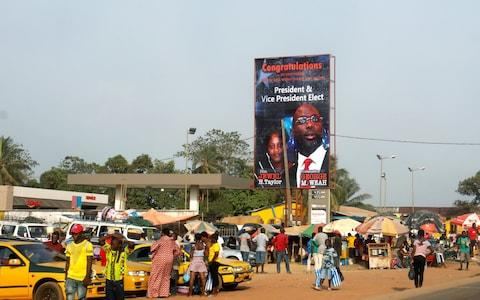 A billboard of Liberia's new President George Weah and his vice president Jewel Howard-Taylor - Credit: REUTERS/Thierry Gouegnon