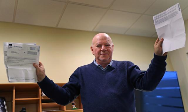 CONCORD, MA - FEBRUARY 27: Arnie Greenfield holds up loan papers in Concord, MA on Feb. 27, 2019. Greenfield is perplexed because the company servicing his son's student loan won't give him credit for paying the loan early on one occasion. Greenfield says he has no complaints about helping his children pay off their college loans. An engineer and high-tech executive, he says hes grateful to be in a position to do so. But he does have a problem with being penalized by a bank for making an early payment.