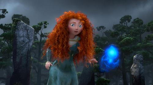 "In this image provided by Disney, Princess Merida, voiced by actress Kelly Macdonald, follows a Wisp in a scene from the animated feature ""Brave."" (AP Photo/Disney-Pixar Animation)"