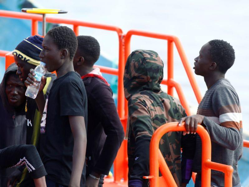 Migrants wait to disembark from a Spanish coast guard vessel in the port of Arguineguin on the island of Gran Canaria