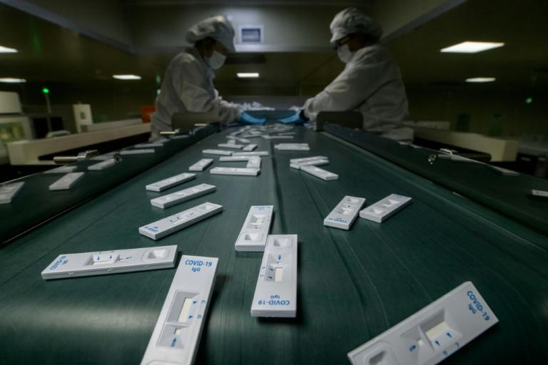 More than 100 workers staff the production lines, where machines pump out the coronavirus test kits at the rate of 2.5 per second
