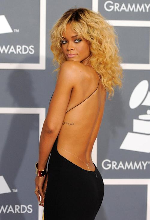 """FILE - This Feb. 12, 2012 file photo shows Rihanna at the 54th annual Grammy Awards in Los Angeles. CBS has issued a memo to Grammy Awards attendees against baring too much skin at the ceremony Sunday. The network requests that """"buttocks and female breasts are adequately covered"""" for the televised award show. The memo sent out Wednesday, Feb. 6, 2013, also warned against """"see-through clothing,"""" exposure of """"the genital region"""" and said that """"thong type costumes are problematic."""" (AP Photo/Chris Pizzello, file)"""