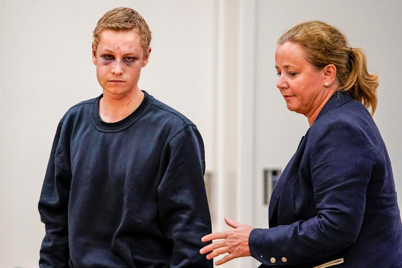 Philip Manshaus, who is suspected of an armed attack at Al-Noor Islamic Centre Mosque and killing his stepsister, appears at a court hearing with his lawyer Unni Fries in Oslo, Norway.