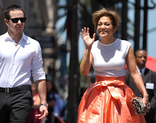 Jennifer Lopez, right, and Casper Smart appear at a ceremony honoring her with a star on the Hollywood Walk of Fame on Thursday, June 20, 2013 in Los Angeles. (Photo by John Shearer/Invision/AP)