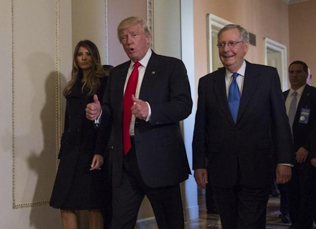 President-elect Donald Trump, flanked by his wife Melania and Senate Majority Leader Mitch McConnell of Ky., gives a thumbs-up while walking on Capitol Hill in Washington, Thursday, Nov. 10, 2016, after their meeting. (Photo: Molly Riley/AP)