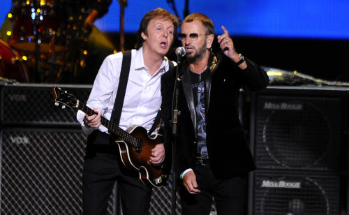 FILE - This April 4, 2009 file photo shows Paul McCartney, left, and Ringo Starr performing at the Change Begins Within Concert in New York. The Recording Academy announced Tuesday, Jan 14, 2014, that both McCartney and Starr will perform at the Jan. 26 Grammy awards show. The Beatles will be honored at the Academy's Special Merits Awards a day before, and a day after the big show, the iconic group will be the center of a performance special featuring Eurythmics and other acts playing Beatles hits. (AP Photo/Stephen Chernin, File)