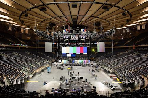 "Workers prepare Madison Square Garden for the ""12-12-12"" concert whose proceeds will aid the victims of Superstorm Sandy, Tuesday, Dec. 11, 2012, in New York. The Dec. 12 concert will feature artists Bon Jovi, Eric Clapton, Dave Grohl, Billy Joel, Alicia Keys, Chris Martin, The Rolling Stones, Bruce Springsteen & the E Street Band, Eddie Vedder, Roger Waters, Kanye West, The Who and Paul McCartney. (AP Photo/John Minchillo)"