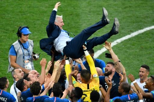 France coach Didier Deschamps is thrown into the air by his players after their World Cup win