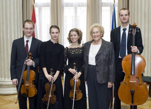 In this Aug. 31, 2012 photo provided by the Austrian parliament 95 year-old soprano Hilde Zadek, second right, poses with musicians of the Tritonius Arts Quartett after being awarded with the Great Medal of Honor of the Austrian Republic, at the parliament in Vienna, Austria. For Zadek, the city she once despised as part of Hitler's evil empire has long become a home that she says she would never leave _ and one that is proud to call her own. She has been showered with medals, granted high honorary titles and a singer's competition named after her 13 years ago has turned into an international launching pad for future opera stars. (AP Photo/Parlamentsdirektion/Bildagentur Zolles KG/Jacqueline Godany)