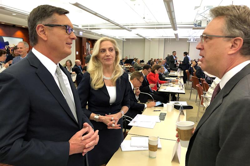 Federal Reserve Governor Lael Brainard (C) speaks with Fed Vice Chair Richard Clarida (L) and New York Fed President John Williams (R) at the Federal Reserve Bank of Chicago in Chicago, Illinois, U.S., June 5, 2019. REUTERS/Ann Saphir