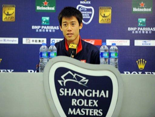 Kei Nishikori of Japan answers a reporter's question during a press conference