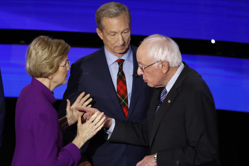 FILE - In this Jan. 14, 2020, file photo, Democratic presidential candidate Sen. Elizabeth Warren, D-Mass., left and Sen. Bernie Sanders, I-Vt. after a Democratic presidential primary debate hosted by CNN and the Des Moines Register in Des Moines, Iowa. Candidate businessman Tom Steyer looks on. As the Democratic primary intensifies ahead of the first voting contests, President Donald Trump and his allies have issued a series of favorable comments about Democrat Bernie Sanders. It's a strategy aimed at trying to take advantage of Democratic divisions and trying to attract some Sanders' supporters to Trump's campaign if the senator is not his party's nominee.(AP Photo/Patrick Semansky, File)