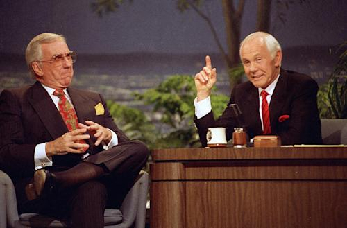 """In this May 22, 1992 file photo, Ed McMahon, left, and host Johnny Carson are shown on """"The Tonight Show"""" for their final broadcast in Burbank, Calif. With his debut as host of NBC's """"The Tonight Show"""" 50 years ago this October, until he retired from the show on May 22, 1992, he was seen by more people on more occasions than anyone else in American history. """"Johnny Carson: King of Late Night,"""" a two-hour """"American Masters"""" portrait premiers Monday at 9 p.m. EDT on PBS. (AP Photo/Douglas Pizac, file)"""