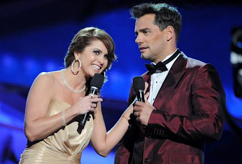 Hosts Lucero, left, and Cristian de la Fuente are seen on stage at the 13th Annual Latin Grammy Awards at Mandalay Bay on Thursday, Nov. 15, 2012, in Las Vegas. (Photo by Al Powers/Powers Imagery/Invision/AP)